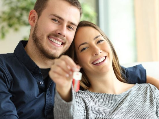 Happy People with Keys to home buying